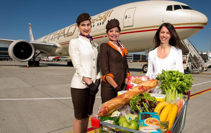 Australian flybuys member Caroline Borg and Etihad Airways ground staff (left to right) Fatima Reda and Nancy Azzi at Melbourne Airport